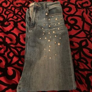 Blue jeans with white and silver pearls accents